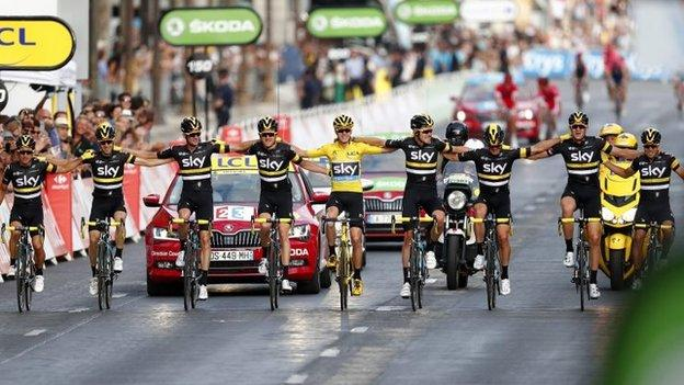 Chris Froome (in yellow) celebrates victory with Team Sky