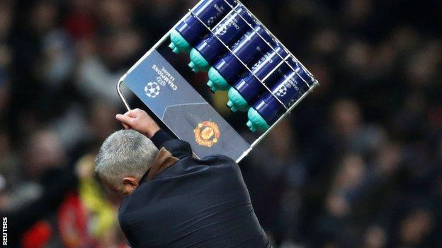 Manchester United manager Jose Mourinho throws a tray of water bottles to the floor after his side's winner against Young Boys in the Champions League