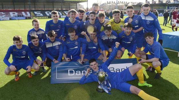 The celebrations get underway at Seaview for the victorious boys of St Columb's