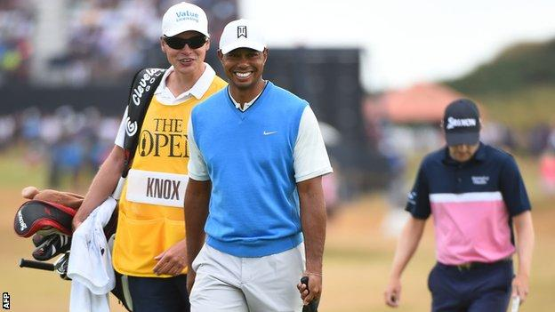 Tiger Woods with a dejected Russell Knox in the background