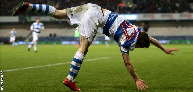 QPR's Paul Smyth celebrate his goal against Cardiff in acrobatic style