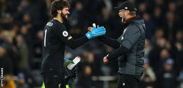Liverpool manager Jurgen Klopp (right) with goalkeeper Alisson
