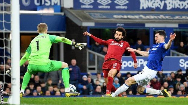 Michael Keane tackles Mohamed Salah
