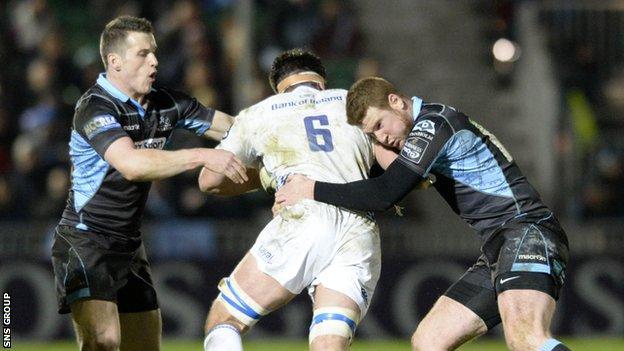 Glasgow Warriors' Mark Bennett (left) and Rory Clegg challenge Leinster's Dominic Ryan