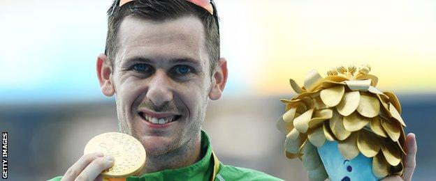 Michael McKillop shows off his Rio gold medal