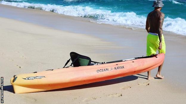 Lewis Hamilton with a kayak