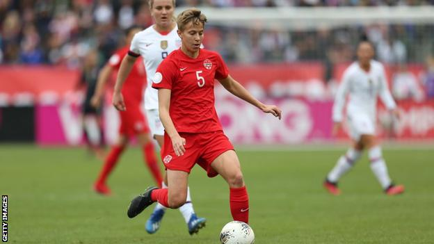 Quinn playing for Canada against the United States