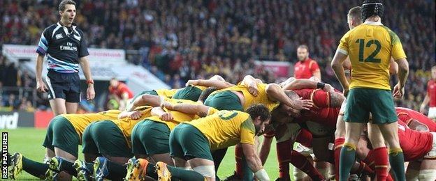 Australia, with Matt Giteau (12) filling in at scrum-half, pack down for a scrum against Wales