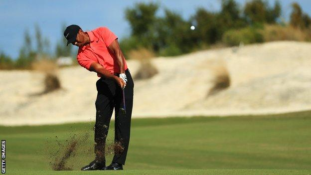 Tiger Woods plays an iron shot at the Hero World Challenge