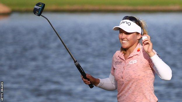 Brooke Henderson celebrates victory at the Lotte Championship