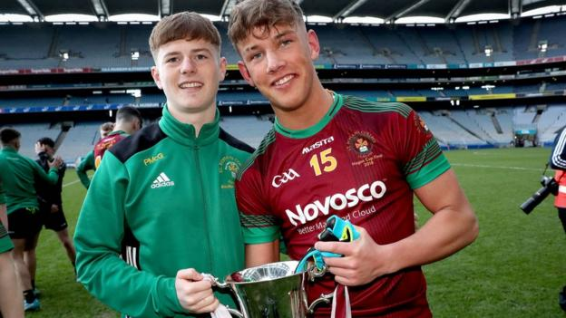 Patrick McGibbon and Eoin McConville celebrate with the trophy after St Ronan's narrow win over Rice College