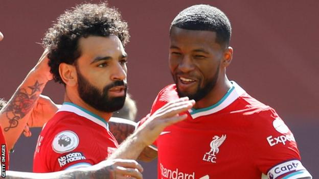 Mohamed Salah (left) celebrates with team-mate Georginio Wijnaldum after scoring against Newcastle United in the Premier League
