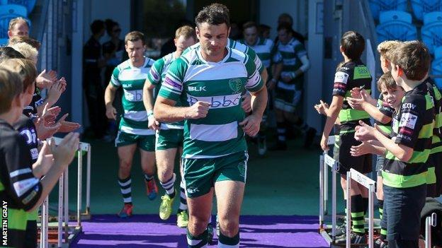 Blair Campbell leads out Guernsey