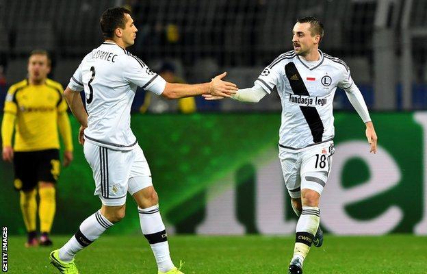 Michal Kucharczyk of Legia Warsaw celebrates scoring his teams third