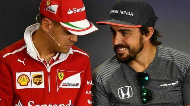 Ferrari driver Sebastian Vettel with Fernando Alonso during his time as a McLaren driver