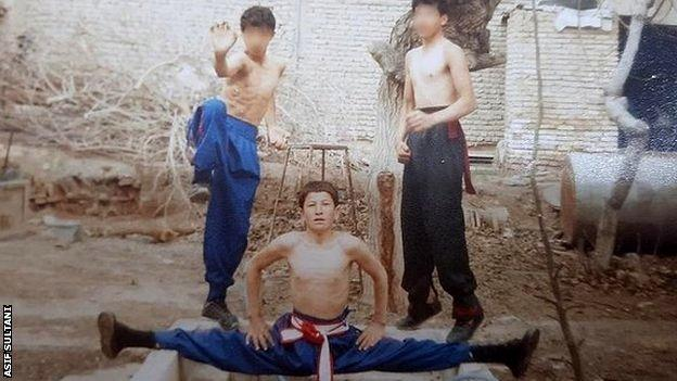 A young Asif Sultani training with friends at home in his backyard dojo