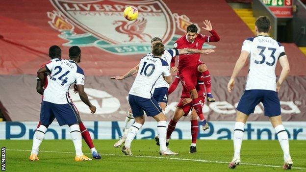 Roberto Firmino scores against Tottenham