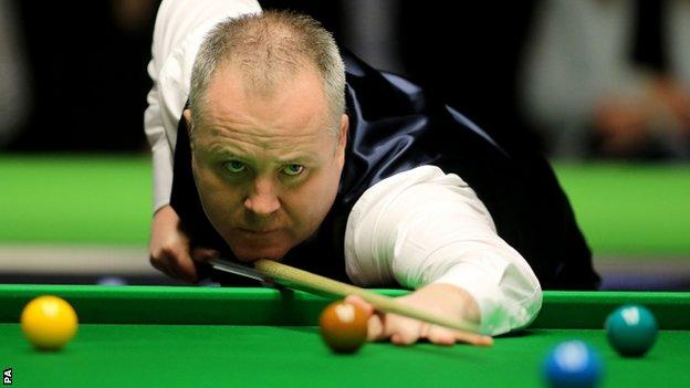 John Higgins plays a shot at the recent UK Championship
