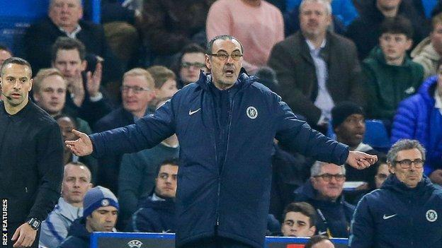 Maurizio Sarri spreads his arms wide to gesture to his players during Chelsea's Europa League second leg against Malmo