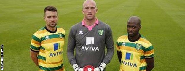John Ruddy and Youssouf Mulumbu model Norwich City's new third kit