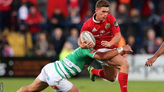 Treviso's Sam Christie tackles Munster fly-half Ian Keatley