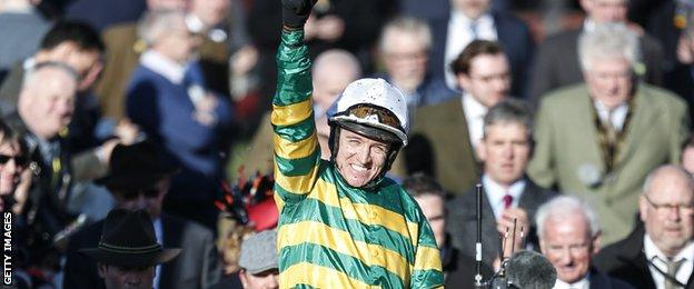Barry Geraghty celebrates after winning the Champion Hurdle, a second successive win for Buveur D'Air in this event