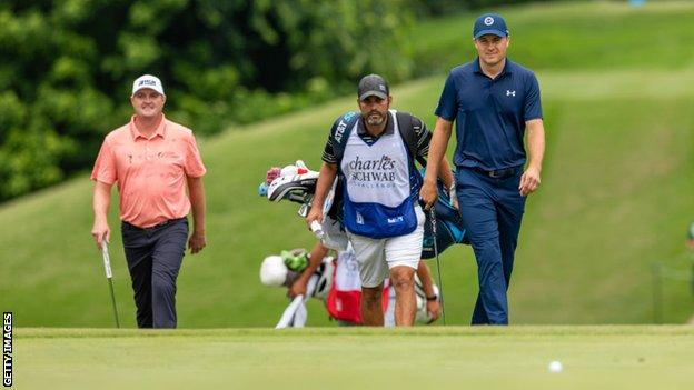 Jordan Spieth and Jason Kokrak walk up to the 8th green during the final round of the Charles Schwab Challenge