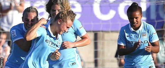 Manchester City's Isobel Christiansen (centre) celebrates scoring her sides second goal with teammates