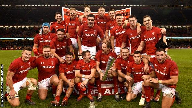 Wales celebrate after completing a clean sweep of autumn victories