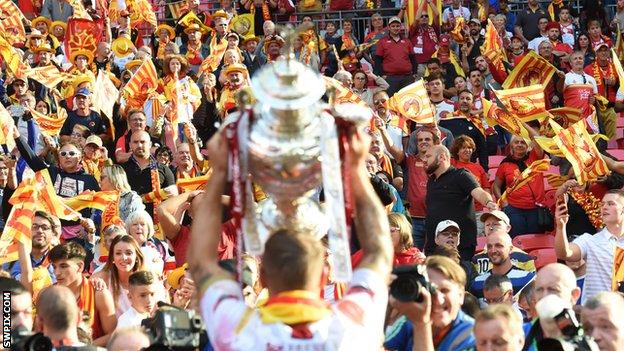 Catalans Dragons fans celebrate the Challenge Cup final win