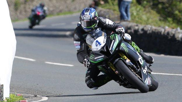 Ian Hutchinson at Tower Bends as he powers his way to victory in the opening Supersport race