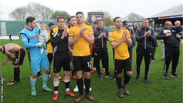 Newport County players applauding fans