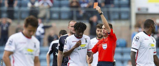 Inverness forward Andrea Mbuyi-Mutombo is sent off by Andrew Dallas at Dens Park