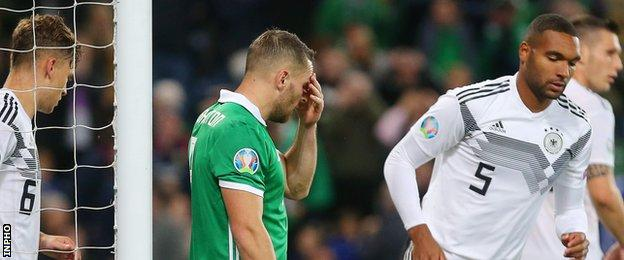 Northern Ireland striker Conor Washington failed to take two good chances in the first half