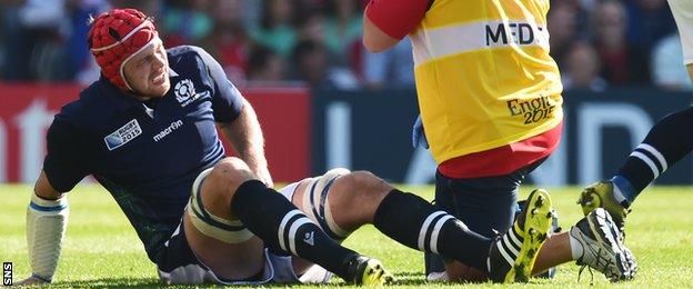 Grant Gilchrist receives treatment in the match against the USA