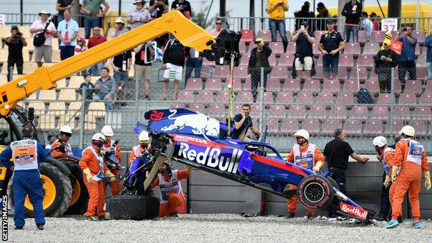 The car of Brendon Hartley is recovered from the track after he crashed during final practice