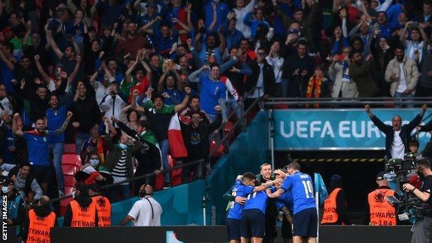 Italian fans celebrating Chiesa's goal in the semi-final against Spain