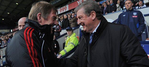 Kenny Dalglish shakes hands with Roy Hodgson