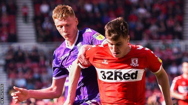 Sam Clucas of Stoke City and Paddy McNair of Middlesbrough