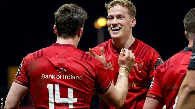 Darren Sweetnam and Mike Haley celebrate Munster's go-ahead try
