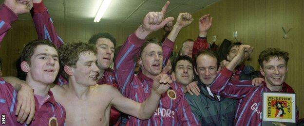 Stenhousemuir players celebrate in the dressing room after beating Aberdeen