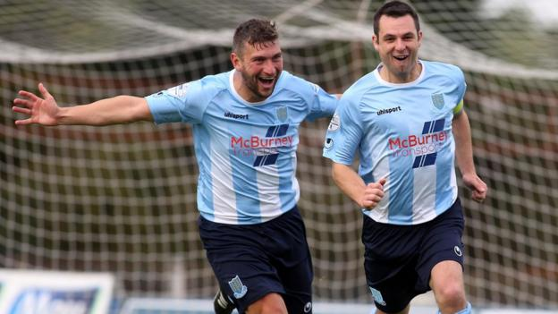Ballymena hat-trick penalty hero Matthew Tipton congratulates skipper Jim Ervin after the defender scored his side's fifth goal