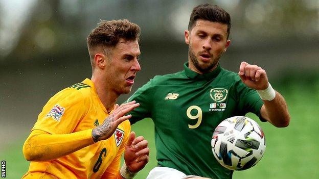 Republic of Ireland striker Shane Long (right)