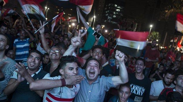 Egyptian fans celebrate as the Pharaohs reach their first World Cup since 1990