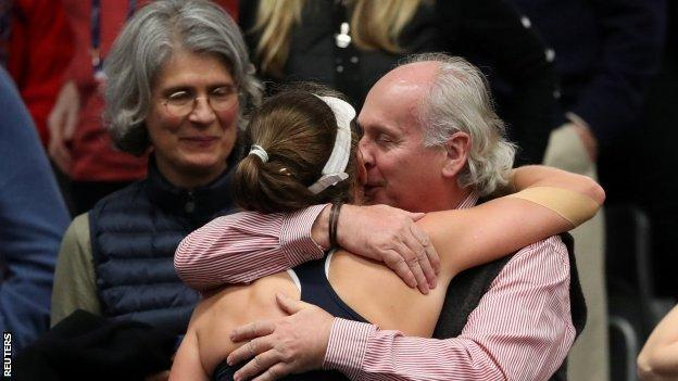 Johanna Konta and her parents hug