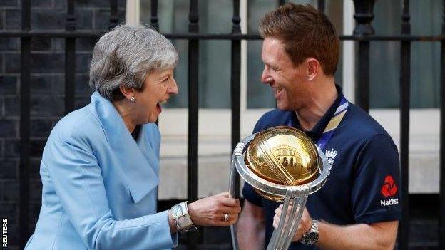 Theresa May and Eoin Morgan