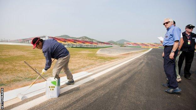 Charlie Whiting inspects the track during the F1 Grand Prix of South Korea at the Korea International Circuit on