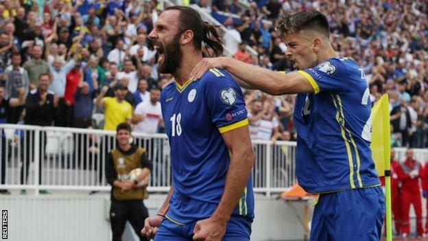 Kosovo players celebrate a goal against the Czech Republic