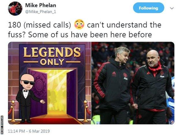 Manchester United assistant manager Mike Phelan reacts on social media