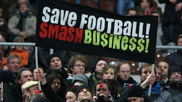 St Pauli fans display a banner reading: Save Football Smash Busine$$